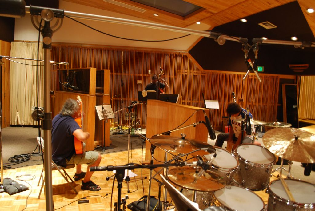 Walfredo Reyes, ( Santana) Thomas Lorenzo recording in Westlake Studios Los Angeles.